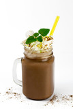 glass jar with cocoa or hot chocolate, straw, marshmallow, cinnamon, whipped cream and branch of mint isolated on white - 221891313