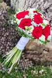 Romantic wedding bouquet for a bride with red roses - 221893125