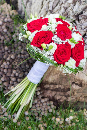 Romantic wedding bouquet for a bride with red roses
