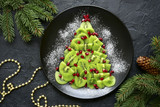 Edible christmas tree from kiwi slices.Top view. - 221901307