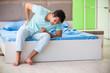 Leinwanddruck Bild - Man suffering from sleeping disorder and insomnia