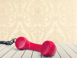 Red telephone receiver  on  background - 221907132