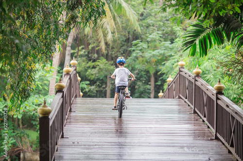 Poster Bangkok: 26 August 2018, female tourists Biking in the park (Bang Kachao, Sri Nakhon Khuean Khan Park and Botanical Garden) Thailand