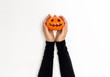Woman holding a halloween pumpkin on a white background