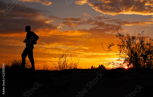 Silhouette of photographer with his camera during sunset © es0lex