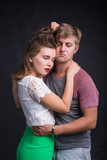 Passionate young people in love on black background