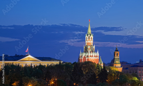 View of the Moscow Kremlin. The Spasskaya Tower with Kremlin chimes at dusk
