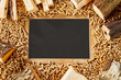 Leinwanddruck Bild - Blackboard surrounded by frame and small pegs