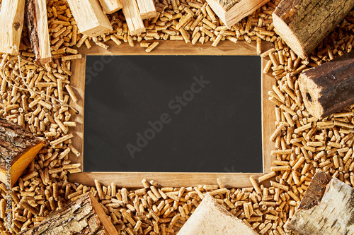 Blackboard surrounded by frame and small pegs - 221946742