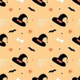 Cute seamless pattern background in cartoon style with witch hats, bones, bats, spiders and spider web for Halloween design. - 221955931