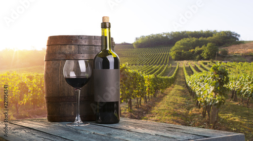 Red wine with barrel on vineyard in green Tuscany, Italy © kishivan