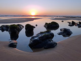 Natural rocks in the water from the atlantic ocean at sunset - 221962500