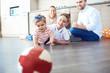 Leinwanddruck Bild - The family plays fun on the floor indoors.