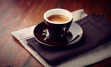 Cup of Espresso Coffee on rustic wooden table. Close-up. Copy space - 221968330