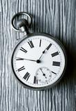 vintage pocket watch on aged wood, retro image - 221971501