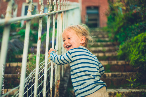 Sticker Laughing toddler in garden