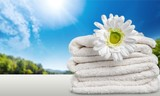 Laundry Basket with colorful towels on background - 221989755