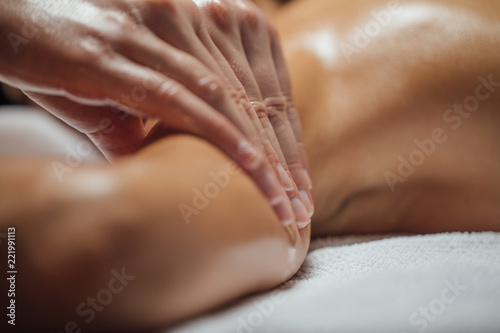 Leinwanddruck Bild Woman Enjoying Arms and Shoulders Massage.