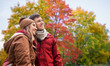 Leinwanddruck Bild - love, relationship and season concept - happy teenage couple hugging over autumn park background