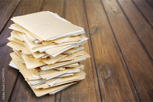File folders with documents on white background - 221991570