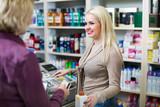 Positive client at shop paying at cash register - 221991736