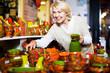 Leinwanddruck Bild - Woman posing with ceramic tableware