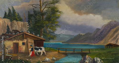 Leinwanddruck Bild Frau bringt an einem See die Kuh in den Stall