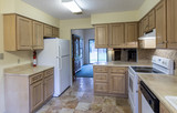 Dated kitchen interior in need of remodel. - 221995795