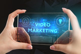 The concept of business, technology, the Internet and the network. A young entrepreneur working on a virtual screen of the future and sees the inscription: Video marketing - 221996716