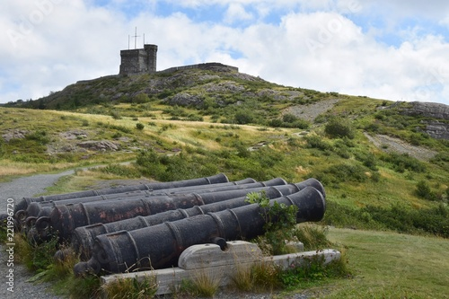 Cannons at Signal Hill, landmark tower in the background;  St John's NL Canada
