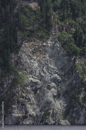 Rock on lake Teletskoe. Altay's mountains. - 221998761