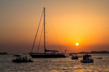 Sunset over sea with boats
