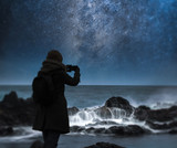 a starry night sky over the ocean. - 222003530