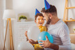 Father and son. Energetic optimistic boy and man playing with balloons while laughing