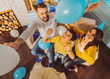 Birthday mood. Glad adorable family celebrating birthday and playing with balloons