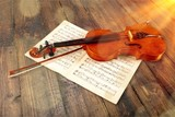 Violin And Musical Notes on desk