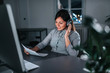 Female customer care operator working night shift in call center. - 222008103