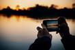 canvas print picture - Sonnenuntergang fotografieren am Okavango Fluss, Namibia