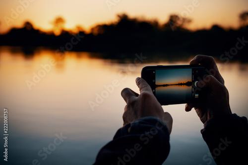 canvas print picture Sonnenuntergang fotografieren am Okavango Fluss, Namibia