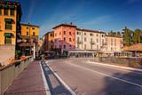 Houses of Peschiera del Garda in morning light - 222011372