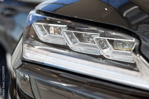 New modern vehicle with elegant head lamps. Front view. - 222015919