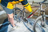 young man clean bicycle with soap and sponge at carwash self-service. lifestyle - 222016528
