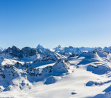 Ski area with amazing view of swiss famous mountains in beautiful winter snow  Mt Fort. The matterhorn and the Dent d'Herens. In the foreground the Grand Desert glacier. - 222018946