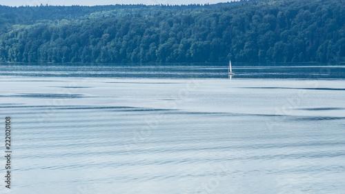 Silent lake water with sailboat enjoying life