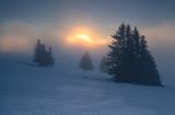 foggy sunrise on snowy mountain top - 222024721