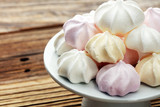 Meringue. Crispy white and pink twisted meringue. Concept love of sweet - 222030749