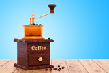 Retro manual coffee grinder on the wooden table, 3D rendering - 222032189
