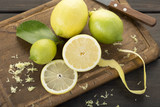 Lemon. Fresh lemons on cutting board