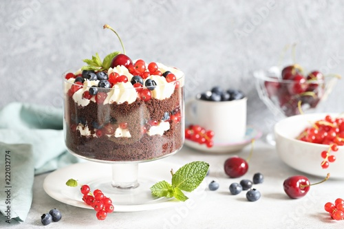 Poster Chocolate and berrie trifle. Layered chocolate dessert with fresh seasonal berries and whipped cream.