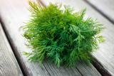 bunch of fresh dill on the wooden surface - 222036356